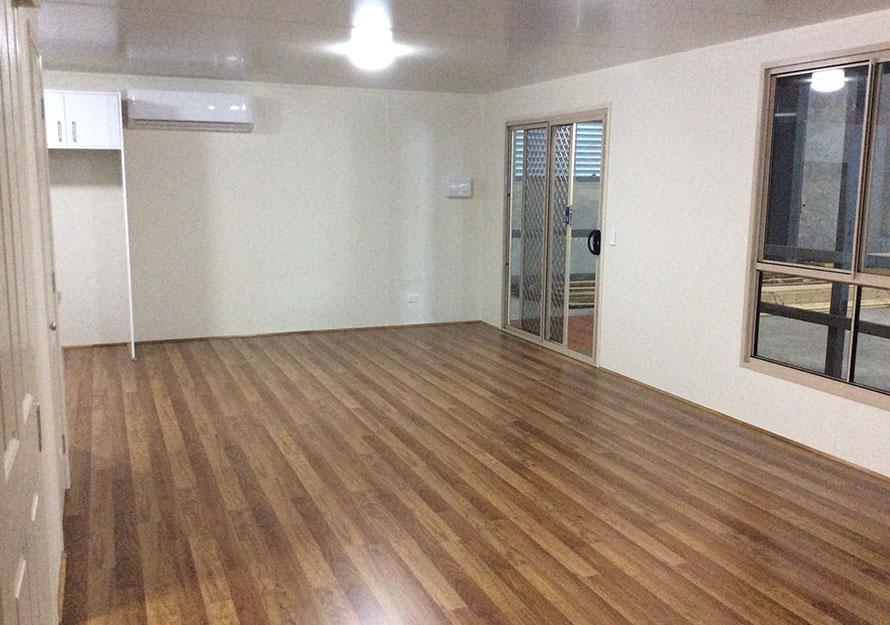 floorboards and a security door granny flat interior
