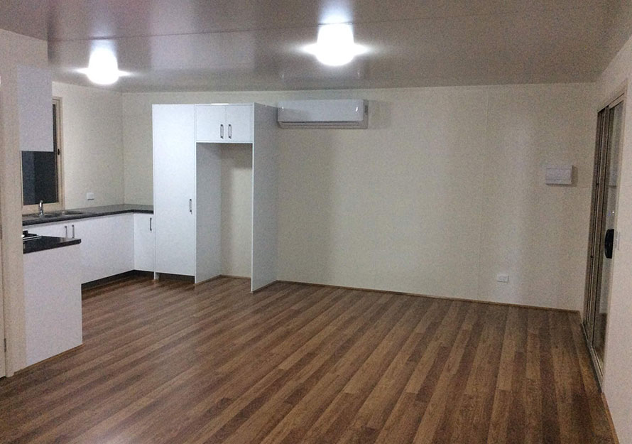 Floorboards and cream walls in a modern granny flat design