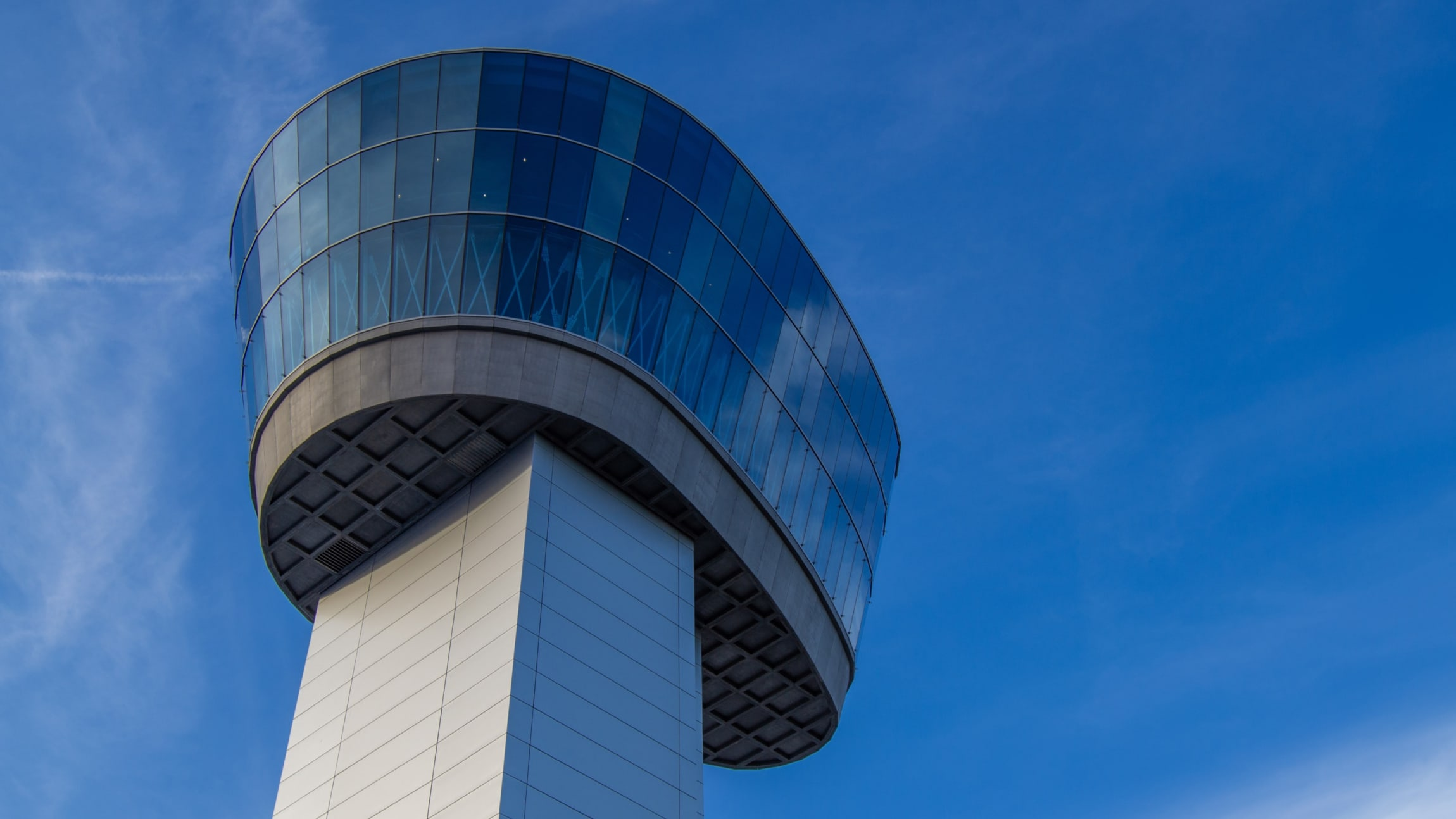 Air traffic controller station set against a blue sky.