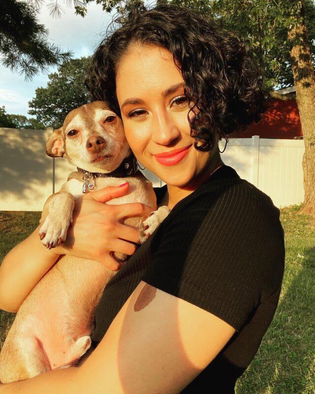 erika gonzalez dog trainer holding her chihuahua mix