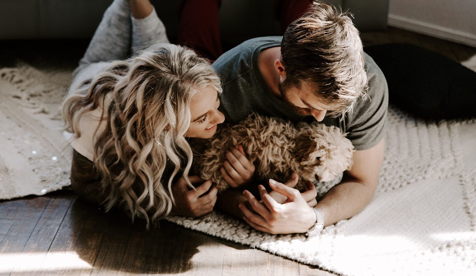 couple laying down with dog