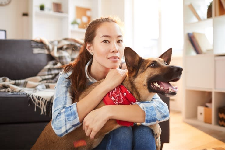woman holding newly adopted dog