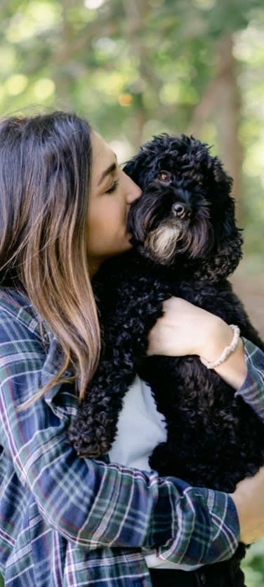 an employee hugging her dog