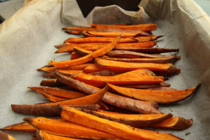 Photo by Louis Hansel on Unsplash of sliced sweet potatoes