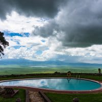 Evening view from a safari lodge on the Ngorongora Crater rim with dark stormy clouds