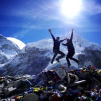 Two people jumping at the Everest Base Camp