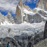 A hiker admires some mountain spires in Patagonia