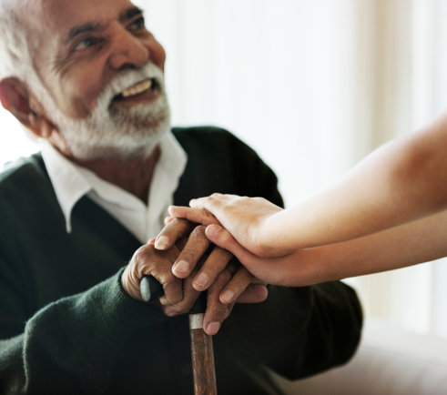 an old black man shaking hands