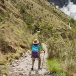 Advanture Woman along Inca Trail surround by Adean Moutain, Machu Picchu, Cusco, Peru