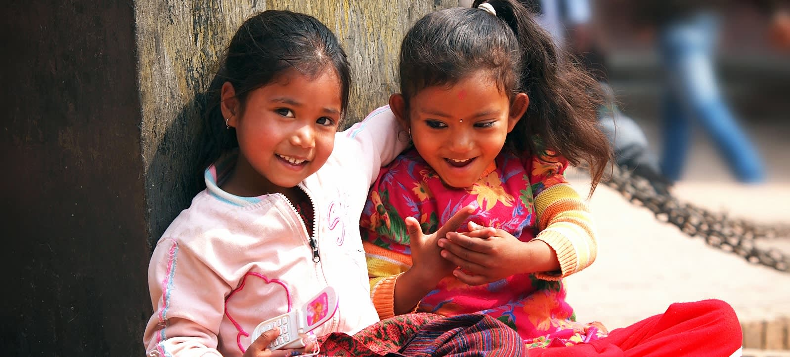 Kids sitting on the street of Kathmandu Enchanting Travels Nepal Tours