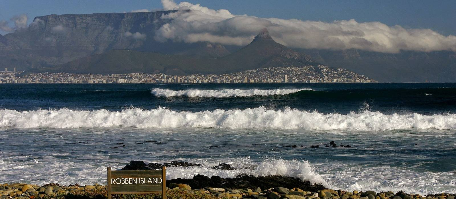Enchanting Travels South Africa Tours Cape Town and Table mountain seen from the beach of Robben Island - history of South Africa