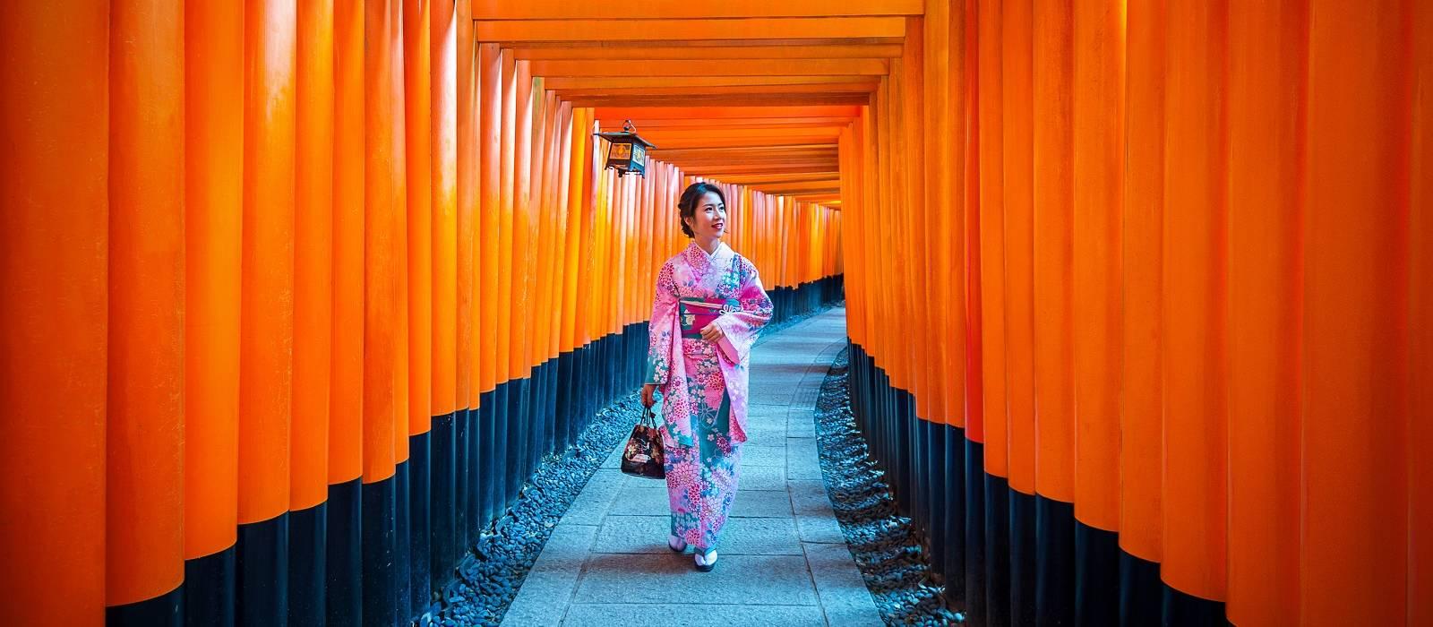 Asian women in traditional japanese kimonos at Fushimi Inari Shrine in Kyoto, Japan - culture of Japan