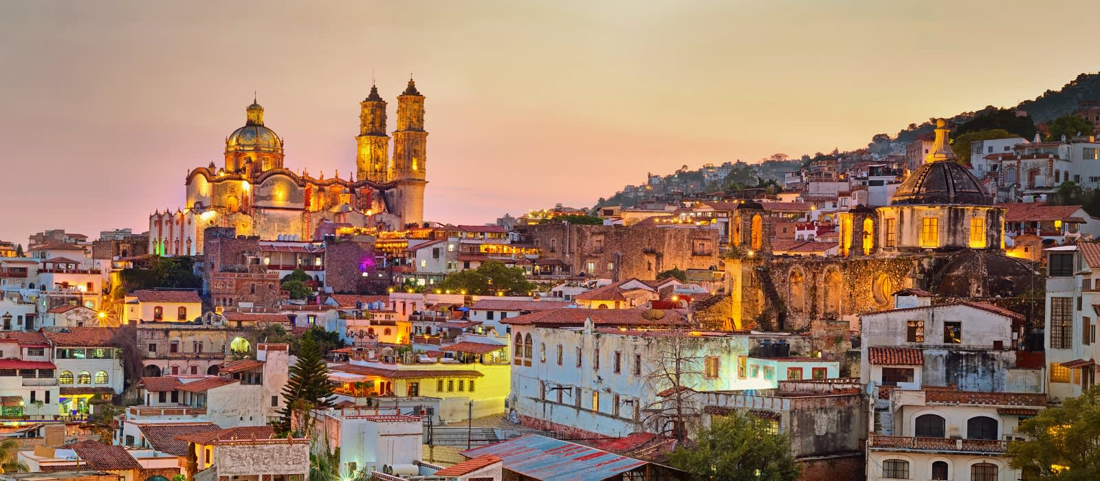 Enchanting Travels Mexico Tours Panorama of Taxco city at sunset in Mexico - things to do in Mexico