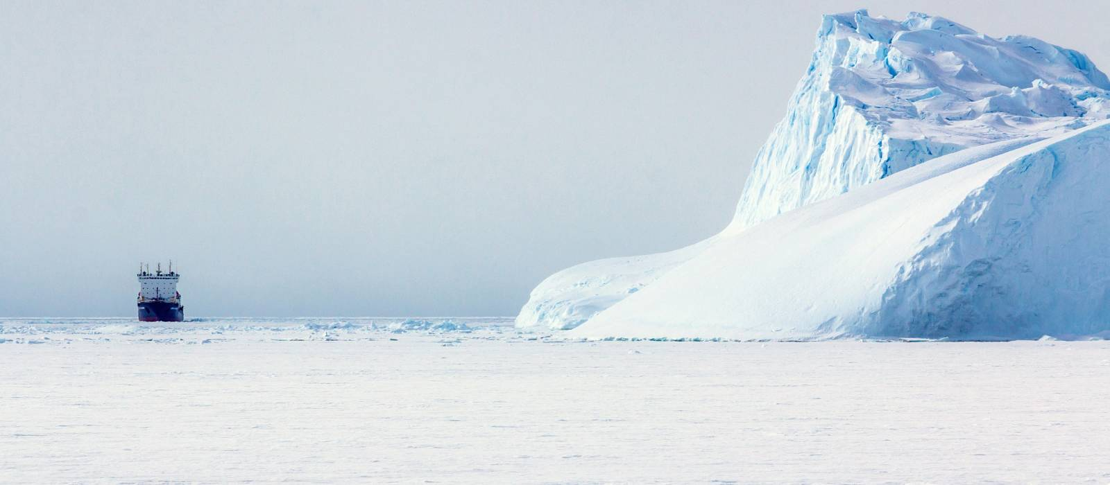 Ship near an icebergs and ice on the water Antarctic - things to do in Antarctica