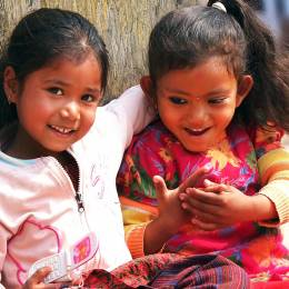 Kids sitting on the street of Kathmandu Enchanting Travels Nepal Tours - Nepal travel guide