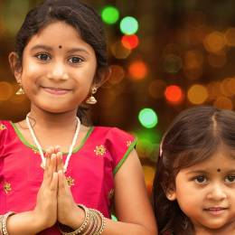 Cute Indian girls greeting you for Diwali - India travel guide