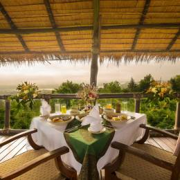 Set table at Four Seasons Tented Camp, Golden Triangle Hotel in Chiang Saen, Thailand