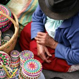 Handmade wicker boxes being sold at a traditional market in Cuenca
