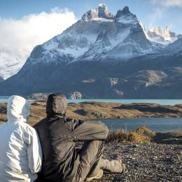 Young couple enjoying the a beautiful scenario in Torres del Paine National Park, Patagonia, Chile, South America