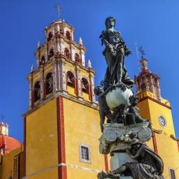 Our Lady of Guanajuato Paz Peace Statue Night Guanajuato, Mexico Statue donated To City by Charles V, Holy Roman Emperor, in the 1500s. Steeple, Towers, Basilica de Nusetra Senora Guanajuato, Mexico