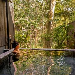 Peaceful Asian Woman in Onsen luxury spa vacation