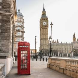 Enchanting Travels UK Ireland Tours London Big Ben tower and a red phone booth Telephone box empty streets