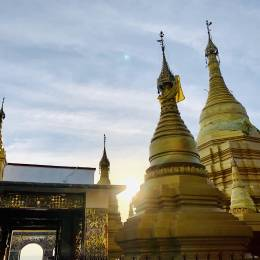 Myanmar_Golden pagodas on top of Mandalay Hill with sun setting in the background