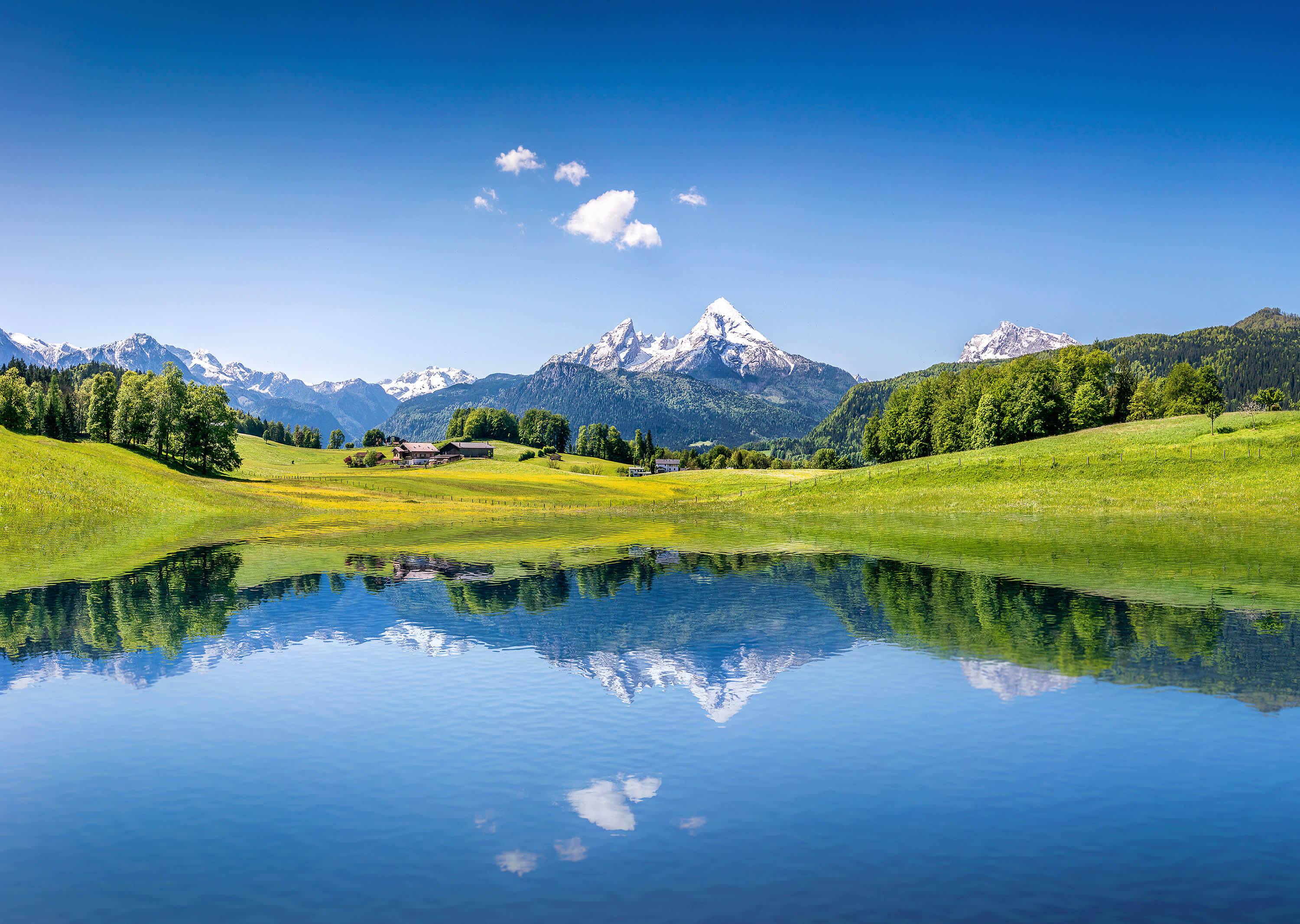 Best time to visit European Capitals - Idyllic summer landscape with clear mountain lake in the Alps