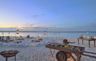Romantic dinner at the beach at hotel Mnemba Island Lodge, Zanzibar, Tanzania - Perfect for Winter travel