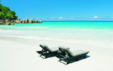 Deckchairs at the beach of Praslin Island, Seychellen