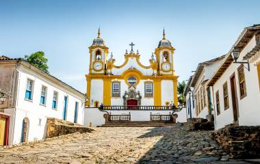 Colorful colonial houses and church in city of Tiradentes