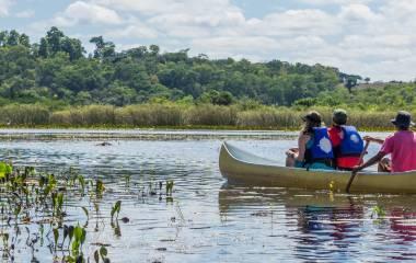 Enchanting Travels Brazil Tours Tourists with a guide in a canoe at Pantanal Marimbus (Marshland Marimbus), Chapada Diamantina, Bahia, Brazil
