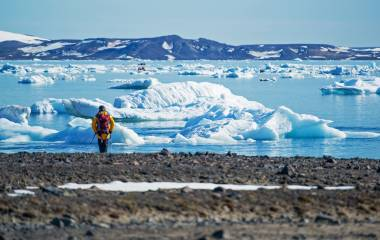 Enchanting Travels Arctic Tours - Man viewing ice floes