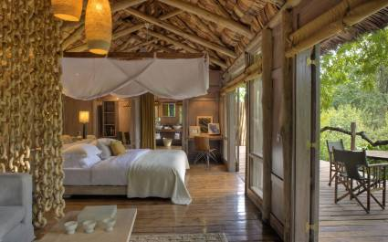 Bedroom at Lake Manyara Tree Lodge in Lake Manyara & Ngorongoro, Tanzania - best luxury vacation spots in the world -