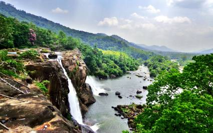 Witness the thundering Athirapally Waterfalls of Kerala during the monsoon season