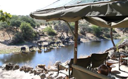 Watching an elephant herd at Meno a Kwena Tented Camp in Kalahari Salt Pans, Botswana