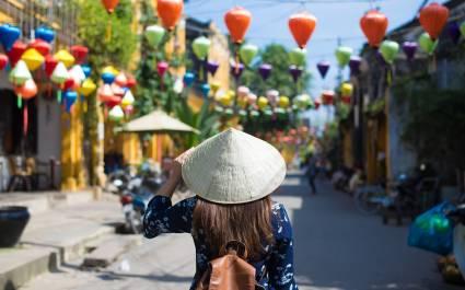 Enchanting Travels Vietnam Tours Hoi An Tourist woman is wearing Non La - best places to visit in 2019
