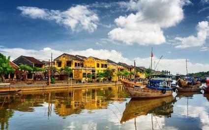Enchanting Travels Vietnam Tours Hoi An Wooden boats on the Thu Bon River in Hoi An Ancient Town (Hoian), Vietnam.