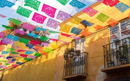 Enchanting Travel Mexico Tours Colorful paper flags over the road