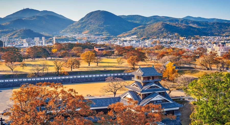 Enchanting Travels Japan Tours Kumamoto Castle Turret and the landscape of Kumamoto, Japan in autumn