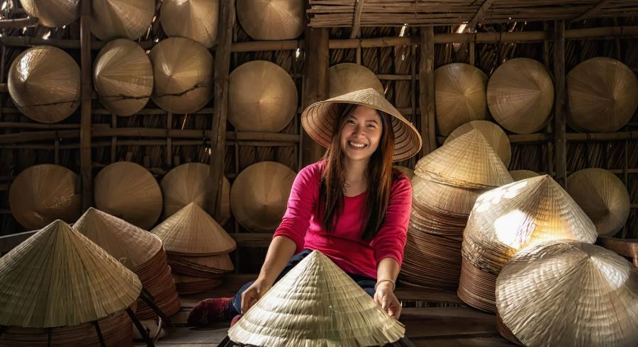 Vietnamese hat-maker in Ho Chi Minh City, Vietnam