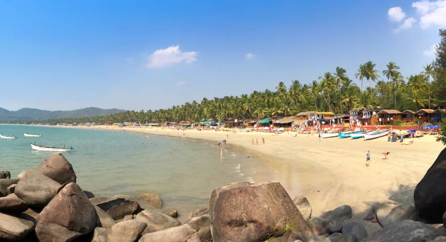 goa beach with people on the shore in India