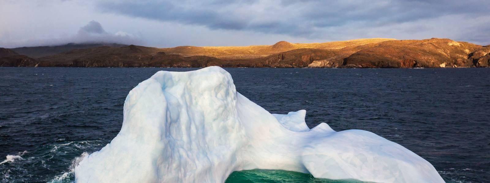 Curved Iceberg Near Torgat Mountains National Park