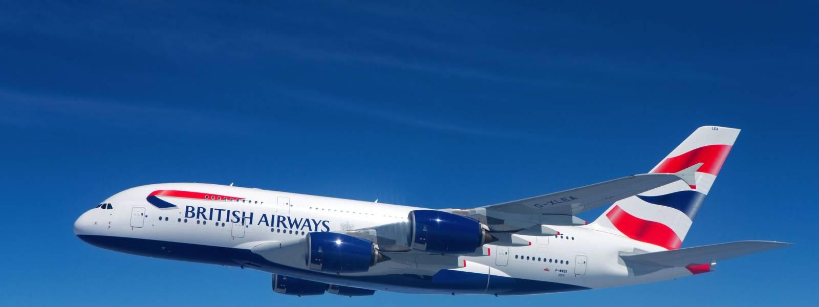 a large passenger jet flying through a blue sky