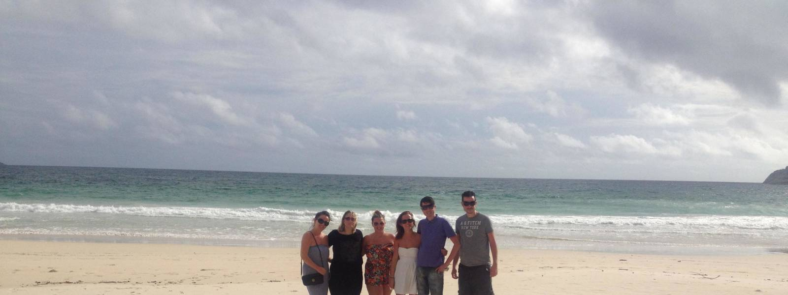 a group of people on a beach