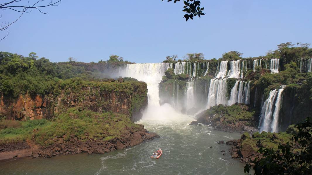 a large waterfall over a body of water
