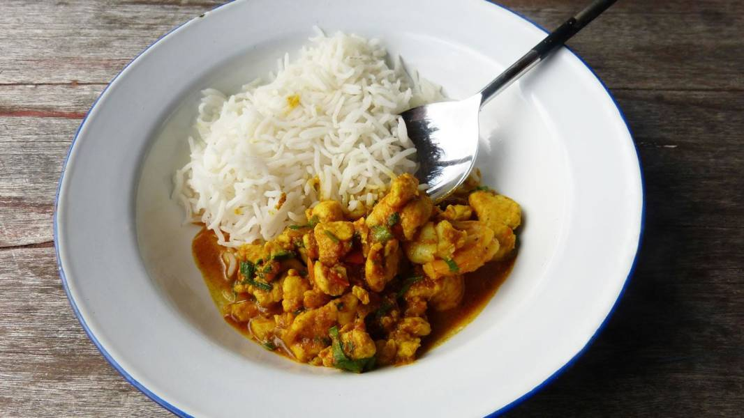 a plate of food with rice