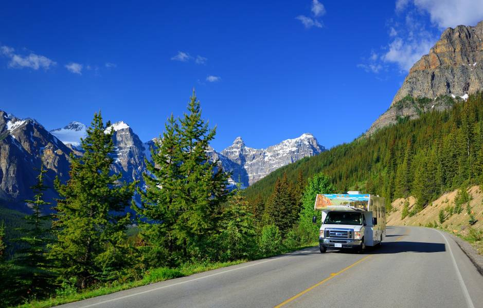 a truck driving down a mountain road