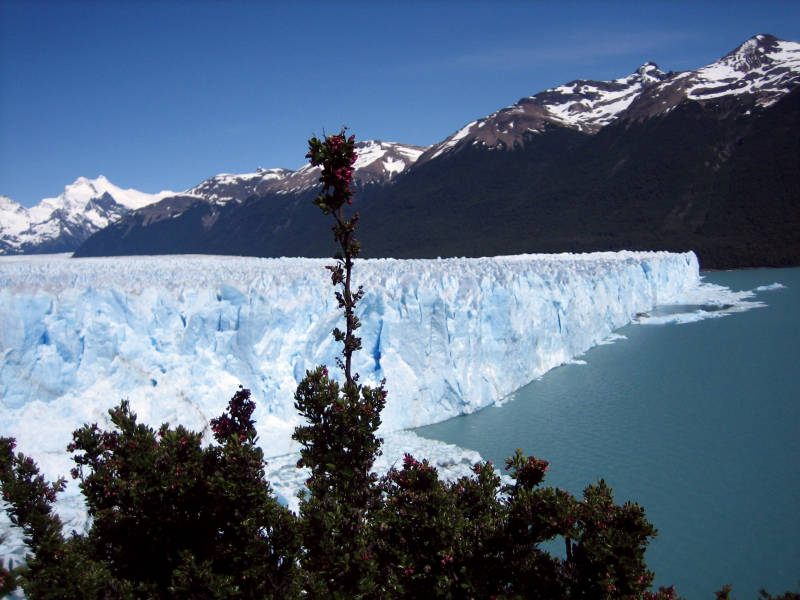 a view of a snow covered mountain with Perito Moreno Glacier in the background