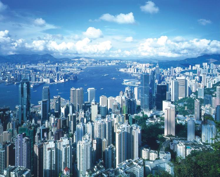 a view of Victoria Peak with a mountain in the background